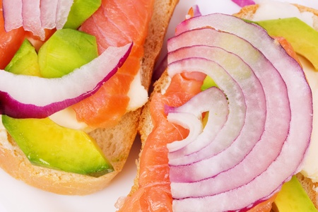 Sandwich with salmon, avocado and onion photo