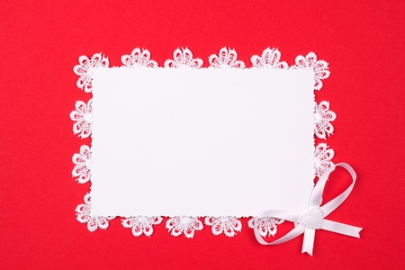 White card for congratulation on a background from red backgound photo