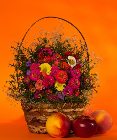 Autumn flowers in a basket and fruit photo