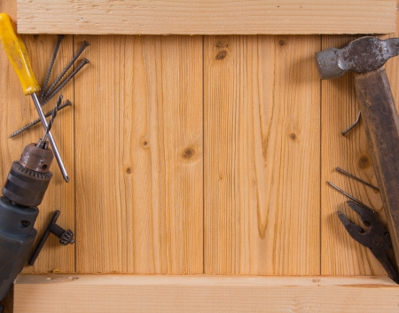 Various hand tools on a wooden background photo