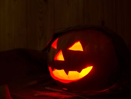 Halloween pumpkin on the table in a rustic barn photo