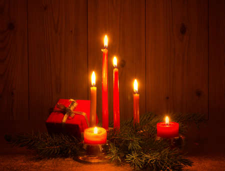 with candles and pine tree branches photo