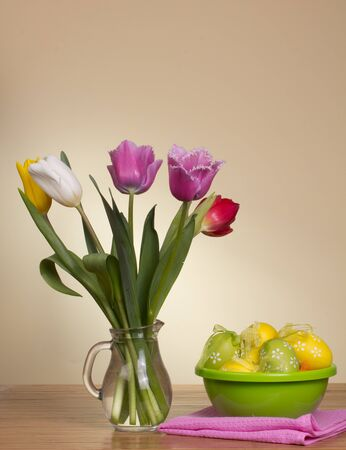 Easter eggs and fresh spring flowers Stock Photo