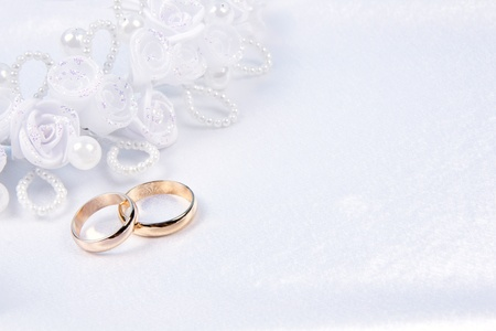 weddings golden rings on white silk Stock Photo