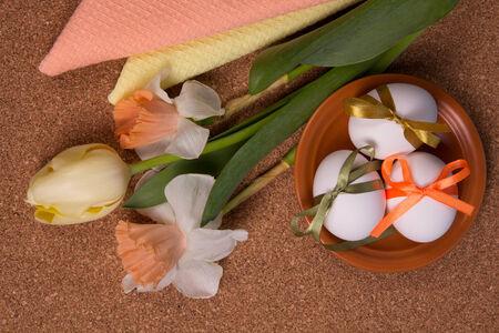 lent: Easter eggs and fresh spring flowers Stock Photo