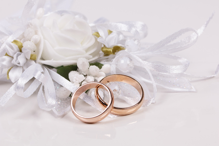 White weddings accessorie and two  golden rings Stock Photo