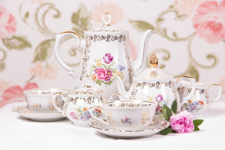 Antique floral tea set on a white tablecloth