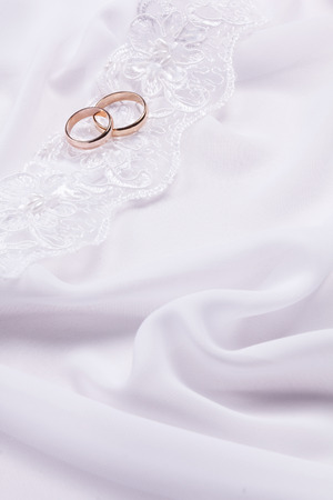 Two  weddings rings on a background a fabric Stock Photo