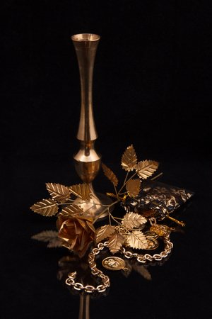 Golden metal products on a dark background photo