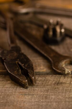 Old rusty tools on an old wooden board