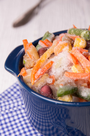 roasting: Frozen vegetables in a crockery before roasting Stock Photo