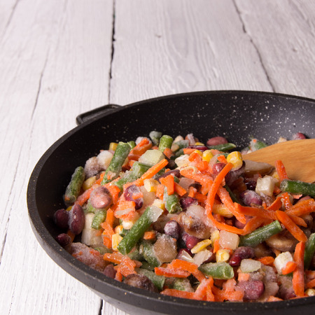 freezed: Frozen vegetables in a pan before roasting