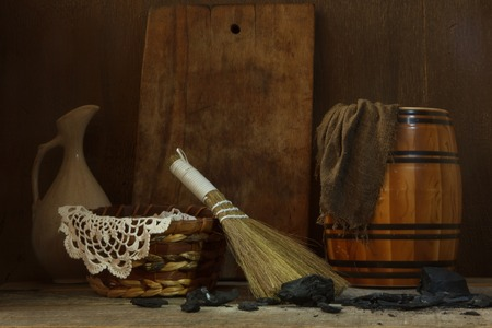 broom handle: Still life with vintage tools for cleaning  and charcoal