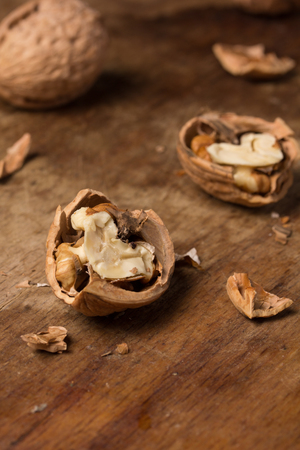 several: Several ripe walnuts on a wooden background