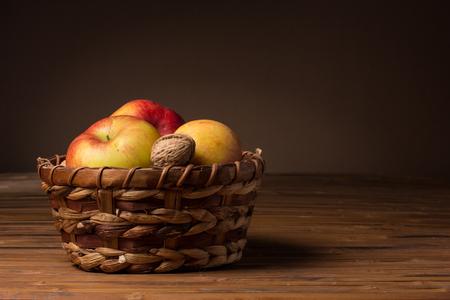 wooden basket: Red fresh apples in a wicker basket