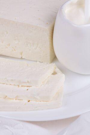 quark: fresh sour cream and  quark  on a white table Stock Photo