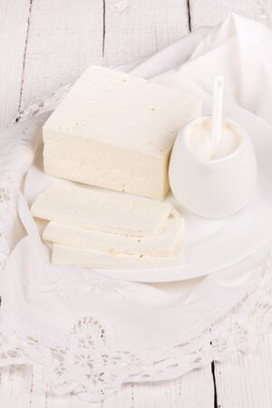 lactic: fresh sour cream and  quark  on a white table Stock Photo