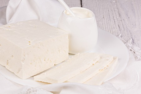 butterfat: fresh sour cream and  quark  on a white table Stock Photo