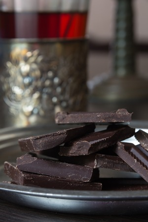 bar ware: pieces of delicious dark chocolate on the table