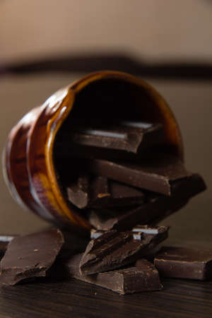 bar ware: pieces of delicious dark chocolate in ceramic ware Stock Photo