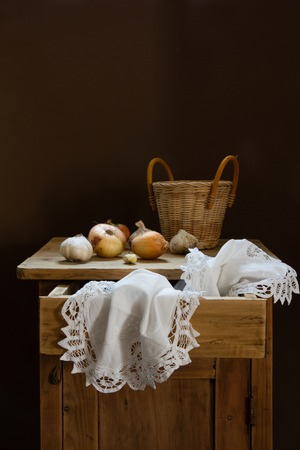 antique dishes: Vintage still life with onion and basket Stock Photo