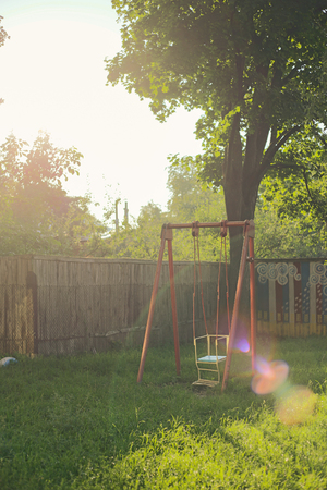 solar flare: Childrens playground in the early morning. Solar flare. Stock Photo