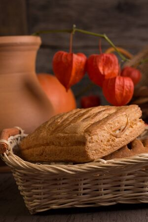 strudel: Fresh sweet strudel on a basket with a red physalis