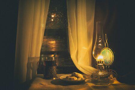 Still life with kerosene lamp near the window. Processing - a soft, diffused light