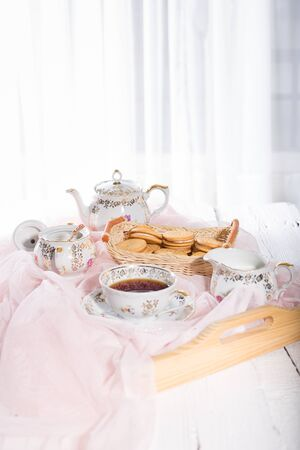 sugar veil: Morning tea concept with cup of tea, teapot and biscuit Stock Photo
