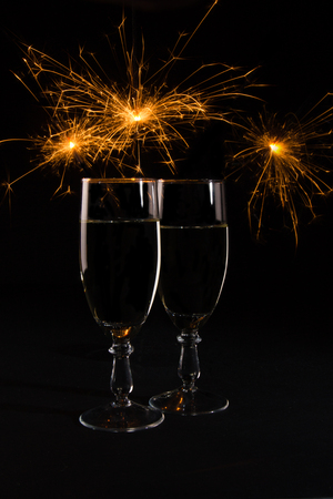 Two glasses with wine on a dark background