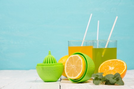 Refreshing drinks from fresh fruit on a turquoise background