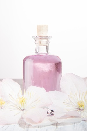 Perfume bottle and fresh white flowers over white stock photo perfume bottle and fresh white flowers over white stock photo 105084217 mightylinksfo