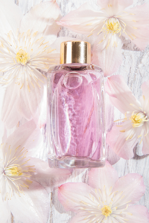 Perfume bottle and fresh white flowers over white stock photo perfume bottle and fresh white flowers over white stock photo 105035392 mightylinksfo