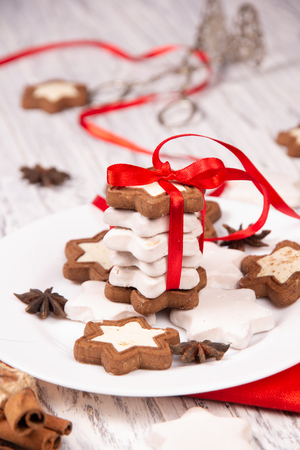 Festive concept with napkin, cookies and spices on a worn white wooden background Banco de Imagens