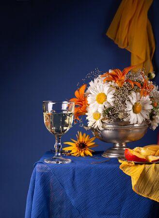 Still life with bright summer flowers on a blue background Reklamní fotografie