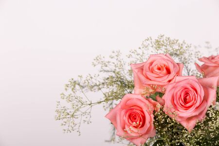 Background with a bouquet of fresh beautiful roses for congratulations