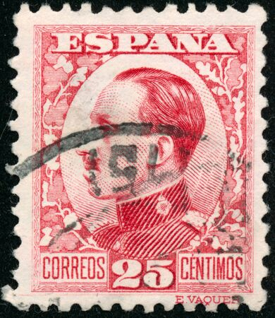POLTAVA, UKRAINE - SEPTEMBER 23, 2019. Vintage stamp printed in in Spain 1930 shows King Alfonso XIII Editorial