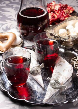 Pomegranate juice in glasses on a silver tray