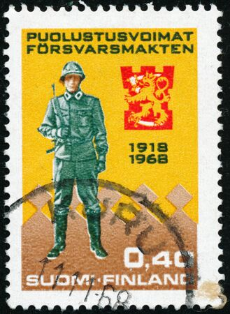 POLTAVA, UKRAINE - January 16, 2020. Vintage stamp printed in Finland circa 1968 show 50th anniversary of the Army