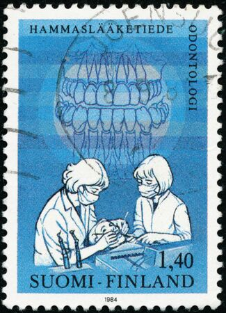 POLTAVA, UKRAINE - January 20, 2020. Vintage stamp printed in Finland circa 1984 show International Dentist congress Sajtókép
