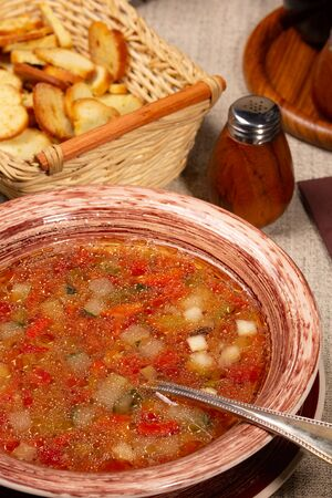Fresh hot vegetable soup in a brown plate Фото со стока