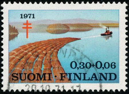 POLTAVA, UKRAINE - May 15, 2020. Vintage stamp printed in Finland circa 1971 show prevention of tuberculosis - Timber Industry