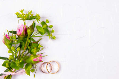 wedding background with place for text and a bouquet of fresh flowers