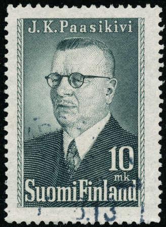 POLTAVA, UKRAINE - October 30, 2020. Vintage stamp printed in Finland circa 1947 show President Paasikivi