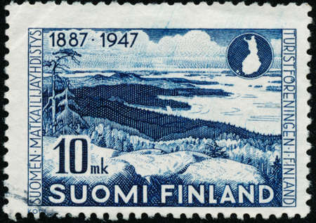 POLTAVA, UKRAINE - October 30, 2020. Vintage stamp printed in Finland circa 1947 show the 60th anniversary of the Finnish Tourist Agency