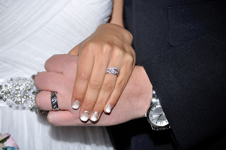 marrage: Hands of newlywedds with wedding rings. Stock Photo