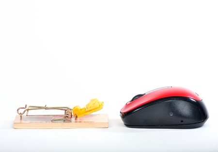 mouse trap facing a computer mouse