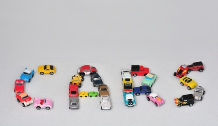 trafic: Toy cars spelling out the word cars Stock Photo