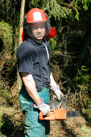 A handsom smiling forestry worker in front of dense wood growth Stock Photo - 1598827