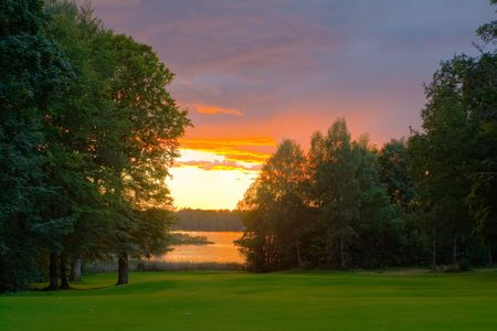 nuances: Sunset over a lakeside golf course. Excellent tone nuances achieved through HDR processing of three different exposes.